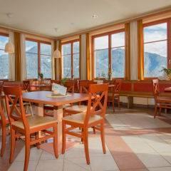 Gemütliches Restaurant mit Panoramablick im JUFA Hotel Gitschtal Landerlebnis. Der Ort für kinderfreundlichen und erlebnisreichen Urlaub für die ganze Familie.