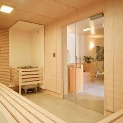 Sauna mit Aufgussschale im Wellnessbereich im JUFA Hotel Bleiburg - Sport-Resort. Der Ort für erholsamen Familienurlaub und einen unvergesslichen Winter- und Wanderurlaub.