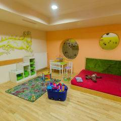 Spielbereich mit Wandbemalung im JUFA Natur-Hotel Bruck. Der Ort für erfolgreiche und kreative Seminare in abwechslungsreichen Regionen.