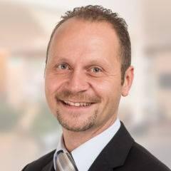 Sie sehen Jürgen Schmuck, Hotelleiter des JUFA Hotel Graz City. Der Ort für kinderfreundlichen und erlebnisreichen Urlaub für die ganze Familie.