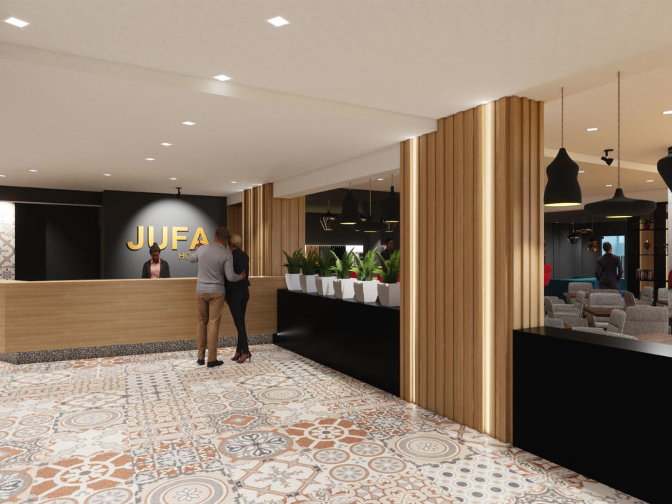 Sie sehen die Rezeption vom JUFA Hotel Salzburg City. Der Ort für erholsamen Familienurlaub und einen unvergesslichen Winter- und Wanderurlaub.