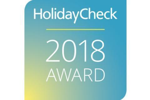 Sie sehen das Logo des HolidayCheck Award 2018 der HolidayCheck AG, das ausgezeichnete Hotels tragen dürfen. JUFA Hotels sind zertifizierter HolidayCheck-Partner.