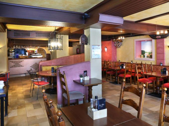 """Sie sehen die gemütliche Pizzeria """"La Trattoria"""" im JUFA Alpenhotel Saalbach****. Der Ort für erholsamen Familienurlaub und einen unvergesslichen Winterurlaub."""