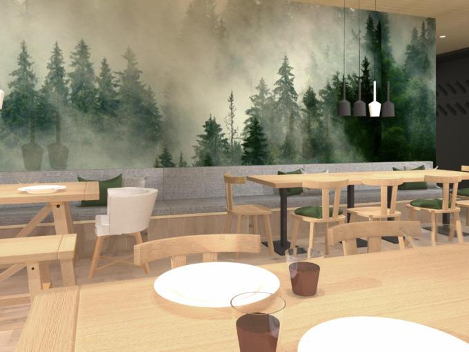 JUFA Savognin Tisch Couch mit Wald im Hintergrund